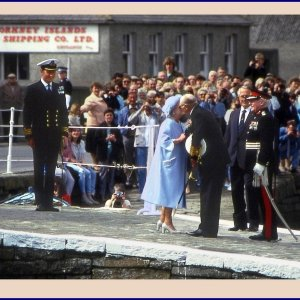 Queen Mother and King Olav of Norway kiss on the slipway
